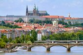 stock photo of bohemia  - VIew of the Prague castle over the bridge on the Vltava river in Prague - JPG