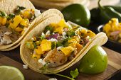 stock photo of mango  - Homemade Baja Fish Tacos with Mango Salsa and Chips - JPG
