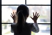 image of school bullying  - Young girl at window  - JPG