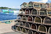 foto of lobster boat  - Piles of lobster traps on the wharf in rural Prince Edward Island - JPG