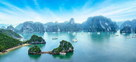 picture of barge  - Tourist junks floating among limestone rocks at early morning in Ha Long Bay South China Sea Vietnam Southeast Asia - JPG