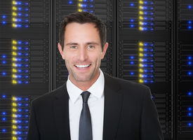 picture of supercomputer  - Photos of businessman standing in front of server racks - JPG