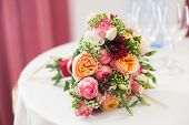 pic of buttercup  - bridal bouquet of roses, buttercups and other flowers on the table