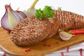 picture of beef-burger  - closeup of grilled beef burgers with fresh onion and pink pepper - JPG
