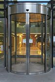picture of revolver  - Automatic revolving door at modern office building - JPG