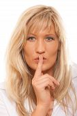 image of hush  - Woman asking for silence or secrecy with finger on lips hush hand gesture - JPG