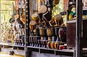 picture of exposition  - hanged thai drums on sale in a stall of the damnoen saduak floating market in Ratchaburi Thailand - JPG
