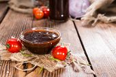 stock photo of marinade  - Small Bowl with homemade Barbeque Sauce on wood - JPG