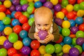 picture of playground  - Little boy having fun in an indoor playground in an activity centre - JPG
