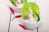 stock photo of dipping  - fresh organic garlic cheese dip salad on a rustic table - JPG