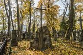 foto of urn funeral  - A very old cemetery photographed in autumn - JPG