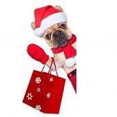 image of dog christmas  - santa claus christmas dog isolated on white background waving hands and shopping on sale - JPG