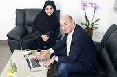 picture of hijabs  - Multiracial Business meeting between a Senior Businessman  - JPG