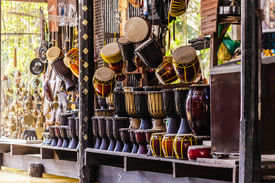 picture of stall  - hanged thai drums on sale in a stall of the damnoen saduak floating market in Ratchaburi Thailand - JPG