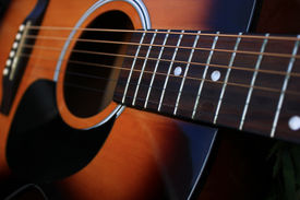 picture of string instrument  - Close up of a six string acoustic guitar. ** Note: Shallow depth of field - JPG