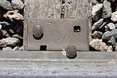 stock photo of spike  - Railroad track tie and spike close up - JPG