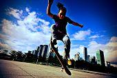 picture of skateboard  - skateboarder practice skateboarding trick - JPG