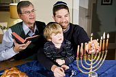 Jewish Family Lighting Hanukkah Menorah