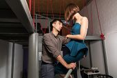 pic of office romance  - Young couple flirting in office - JPG