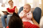 stock photo of sofa  - Baby girl and father playing on sofa - JPG