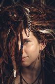 stock photo of dreadlocks  - Close up Face of Pretty Young Female with Tangled Dreadlocks Blond Hair Looking at the Camera - JPG