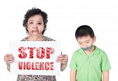 picture of child abuse  - Senior and kid abuse or elder and child mistreatment with a black eye bruised and injured holding Stop violence horizontal paper - JPG