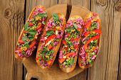 pic of scallion  - Vegetarian sandwiches with beetroot bell pepper parsley and scallion on wooden background horizontal - JPG