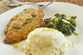 stock photo of marsala  - Crispy breaded chicken marsala with mashed potatoes and broccoli rabe with garlic - JPG