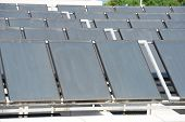 foto of roof-light  - Solar water heating panel on a house roof - JPG