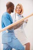 picture of upstairs  - Side view of two confident doctors moving upstairs and talking - JPG