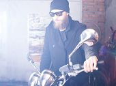 stock photo of chopper  - Portrait of a man and his chopper motorcycle - JPG