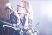 foto of chopper  - Attractive young woman driving a shiny chopper - JPG