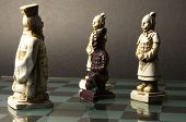 stock photo of humility  - Black pawn on his knees in front of the white king - JPG