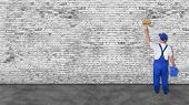 picture of mural  - house painter covers very long white brick wall - JPG