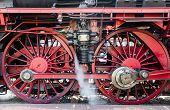 picture of train-wheel  - historic steam train in the snow in the mountains of Switzerland - JPG