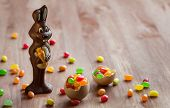 pic of easter candy  - Chocolate Easter Bunny with sweet candy on the wooden table - JPG