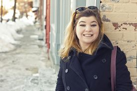 image of early 20s  - Friendly girl early 20s on location going about her everyday life - JPG