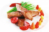 image of chives  - hot fresh grilled red beef meat fillet with vegetables  green chives and peppers on china plate isolated over white background - JPG