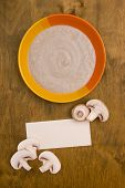 picture of champignons  - Mushroom soup puree of champignons with paper for posting information - JPG