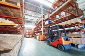 picture of forklift driver  - warehouse forklift stacker loader stacking cardboxes in storehouse  - JPG