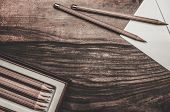 image of charcoal  - Luxurious charcoal drawing pencils on a wooden table  - JPG