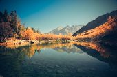 image of mountain-high  - Scenery of high mountain with lake and high peak on a clear day - JPG