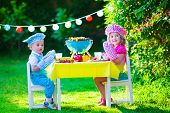 stock photo of bbq party  - Children grilling meat - JPG