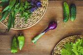 pic of green onion  - Greens green salad cucumber pepper onion Basil on a wooden Board - JPG