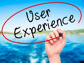 picture of experiments  - Man Hand writing User Experience with black marker on visual screen - JPG