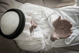 stock photo of muslim man  - Elderly Muslim Arabic man praying - JPG