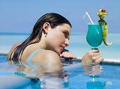 foto of beautiful brunette woman  - Woman in swimming pool - JPG