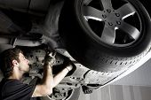 stock photo of car repair shop  - Auto mechanic working at auto repair shop - JPG