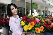 pic of flower shop  - woman with flowers - JPG