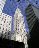 stock photo of empire state building  - View of the Empire State building from the street surrounded by sky scrapers - JPG